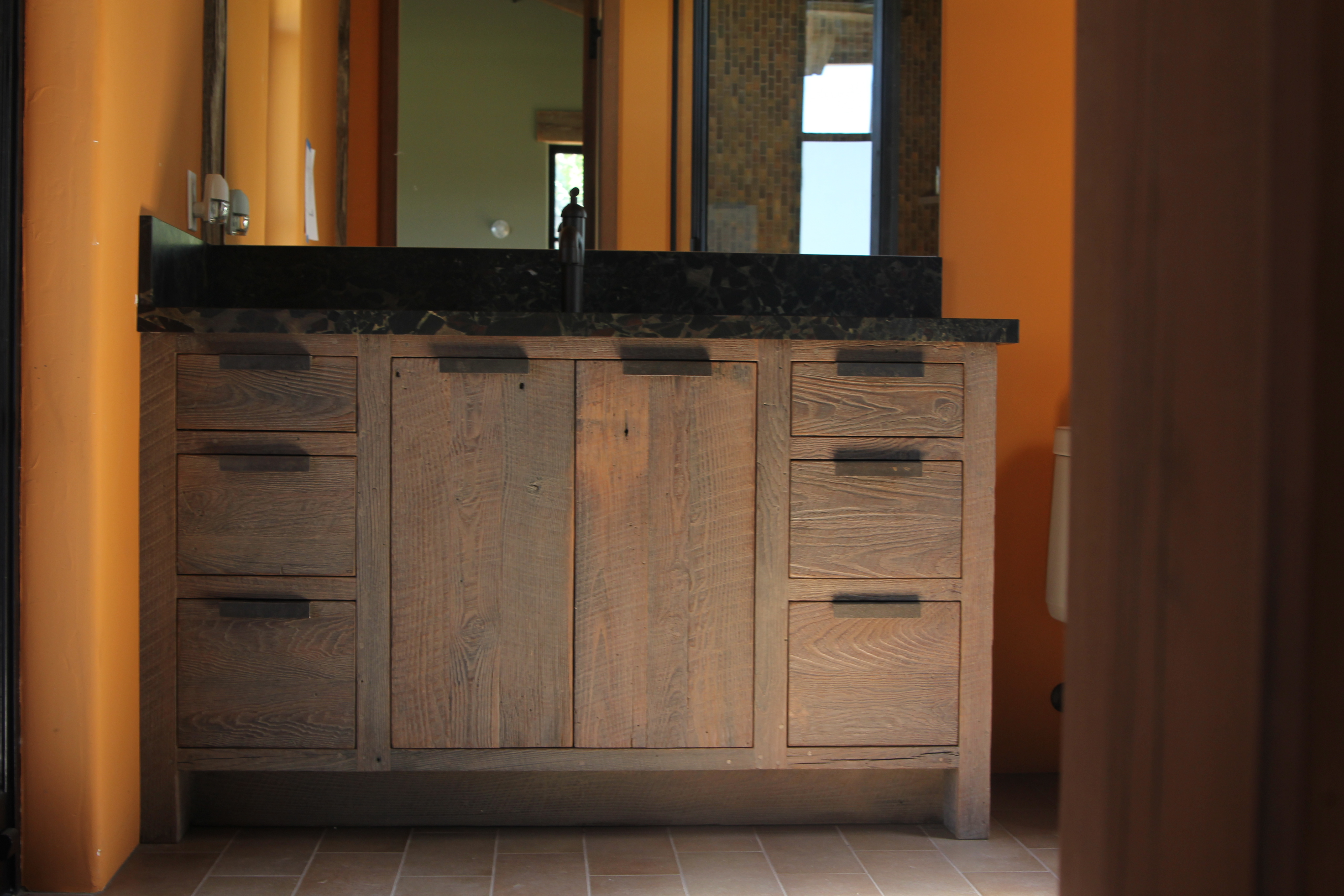 Elegant The Wooden Pallets That Cover The Walls Of This Modern Vanity Bathroom Area And The Wooden Accents Of The Interior Are The Qualities That Give This Space A Beautiful Rustic Charm They Also Provide A Natural Complement To The Trees That You