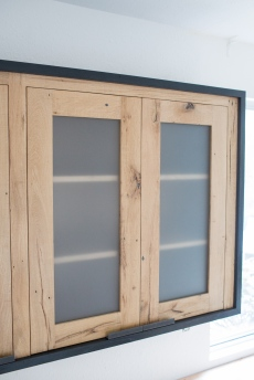 upper cabinets with etched glass panels