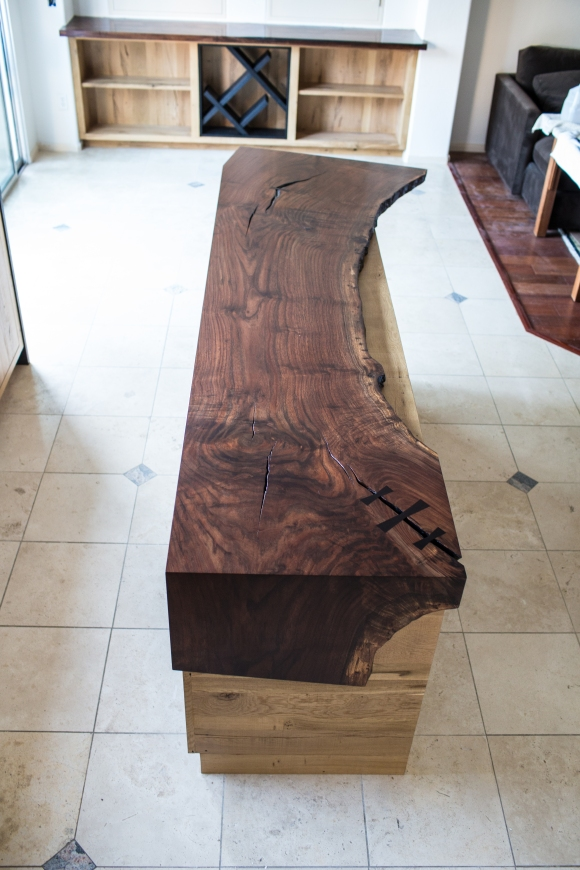 Claro Walnut island counter top with live edge